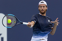 March 25, 2019 - Miami Gardens, Florida, USA - Joao Sousa, of Portugal, returns a shot to Kevin Anderson, of South Africa, during their match at the Miami Open tennis tournament on Monday, March 25, 2019 at Hard Rock Stadium in Miami Gardens, Fla. (Credit Image: © Matias J. Ocner/Miami Herald/TNS via ZUMA Wire)