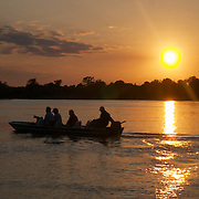 Jaguar viewing tourists on the Cuiaba River, Pantanal, Brazil.