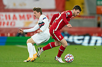 Football - 2020 / 2021 Champions League - Group D - Liverpool vs FC Midtjylland - Anfield<br /> <br /> Liverpool's Andy Robertson slips past Midtjylland's ANDERS DREYER<br /> <br /> COLORSPORT/TERRY DONNELLY