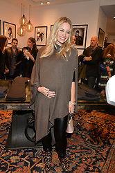 KIMBERLY WYATT at a party to celebrate the launch of the first European John Varvatos Store, 12-13 Conduit Street, London held on 3rd September 2014.