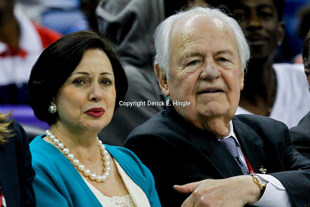 October 9, 2012; New Orleans, LA, USA; New Orleans Hornets and New Orleans Saints owner Tom Benson (right) and his wife Gayle Benson (left) watch courtside during the second half of a preseason game against the Charlotte Bobcats at the New Orleans Arena. The Hornets defeated the Bobcats 97-82.  Mandatory Credit: Derick E. Hingle-US PRESSWIRE