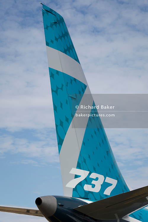 The tail of a Boeing 737 at the Farnborough Airshow, on 16th July 2018, in Farnborough, England.