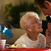 Entertainer Dean Mathis, upper right, sang a song to Dorothy Lappeneit, center, who celebrated her 106th birthday at Plaza Manor, 4330 Washington in Kansas City, Mo.