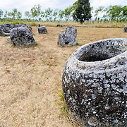 A cluster of stone jars at Site 1 of the Plain of Jars in north-central Laos. Much remains unknown about the age and purpose of the thousands of stone jars clustered in the region. Most accounts date them to at least a couple of thousand years ago and theories have been put forward that they were used in burial rituals.