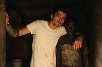 Zayn Malik visits Christopher (15) one roomed house which he shares with his brother and friend in Agbogbloshie slum, Accra.  Christopher has travelled over 800 miles to work on the rubbish dump in the school holidays in order to save enough money to pay for his education