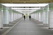 businessmen walking in opposite direction through an corridor