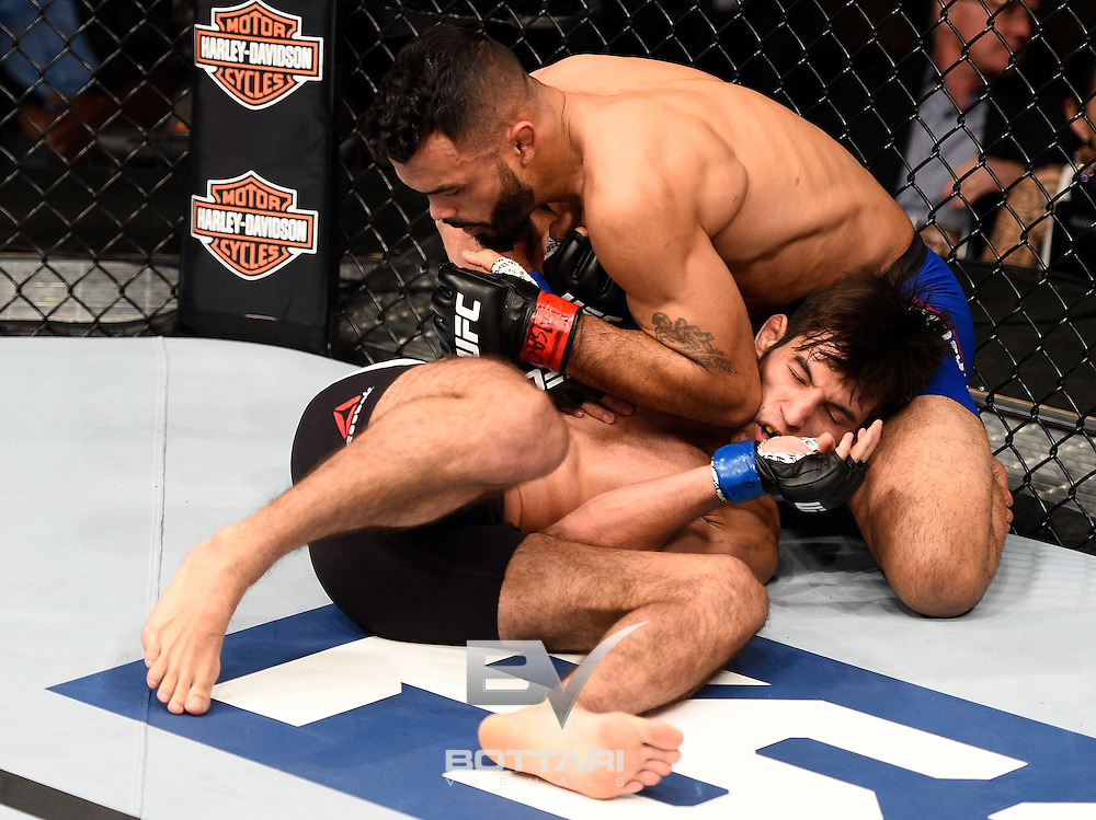 LAS VEGAS, NV - DECEMBER 03:  (L-R) Rob Font elbows Matt Schnell in their bantamweight bout during The Ultimate Fighter Finale event inside the Pearl concert theater at the Palms Resort & Casino on December 3, 2016 in Las Vegas, Nevada. (Photo by Jeff Bottari/Zuffa LLC/Zuffa LLC via Getty Images)