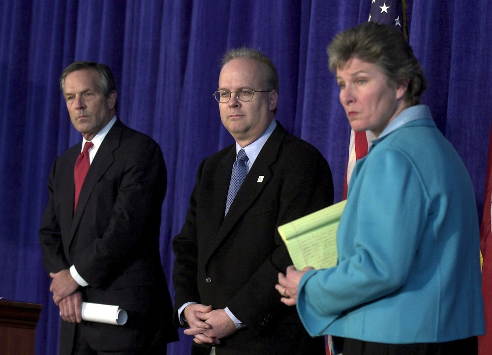 Austin, Texas 09NOV00:  Press Conference in Austin where Bush Communications Director Karen Hughes, Bush campaign chairman Don Evans and chief strategist Karl Rove (blue tie) discuss election results as ballot re-counting continues in Florida.  © Bob Daemmrich  /