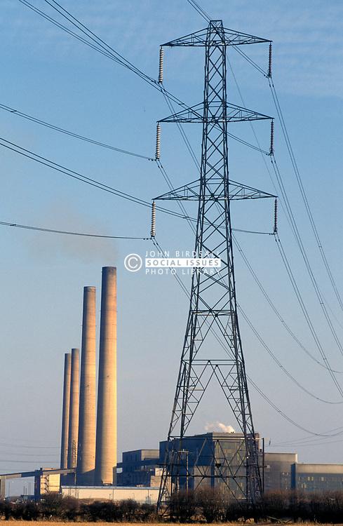 Electricity pylon & Blyth oil fired power station; Northumberland; NE England