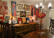 """The dining room, enhanced by framed artwork. Photo taken on January 8, 2019 for """"At Home"""" feature on Sandy Stolberg, who uses dollar store finds as part of the decorations in her Belleville, IL condo.<br /> Photo by Tim Vizer"""