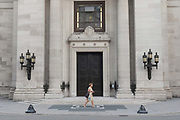 A woman walks past the entrance of Freemasons Hall on the 25th July 2019 in London in the United Kingdom. Freemasons Hall is the headquarters of the United Grand Lodge of England and the principal meeting place for Masonic Lodges in London.
