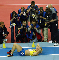 Photo. Javier Garcia<br />14/03/2003 World Indoor Athletics Championship, NIA, Birmingham<br />Carolina Kluft gets the attention of the media after winning the Pentathlon