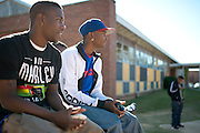 (L to R) Deandrea Frederick and Edgar Smith sit outside of the Grambling State University Natatorium between classes in Grambling, Louisiana on October 23, 2013.  (Cooper Neill for The New York Times)