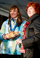 Slovenian bronze medalist cross-country skier Petra Majdic and her mother Vera with strudel at reception at her home town Dol pri Ljubljani after she came from Vancouver after Winter Olympic games 2010, on March 1, 2010 in Dol pri Ljubljani, Slovenia. (Photo by Vid Ponikvar / Sportida)