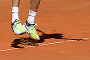 © Filippo Alfero<br /> Monte-Carlo Tennis Masters 2014<br /> Monaco, 17/04/2014<br /> sport tennis<br /> Nella foto: le scarpe di Andreas Seppi (ITA) mentre salta per servire