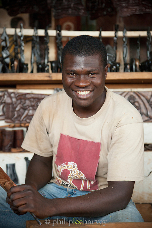 Wood carver at a workshop in the town of Dschang, Cameroon