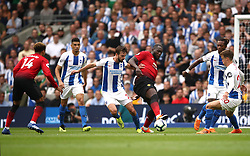 Manchester United's Romelu Lukaku (third right) and Brighton & Hove Albion's Davy Propper (centre) battle for the ball