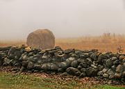 Bale of hay behind a stone wall in the fog in Rhodel Island.