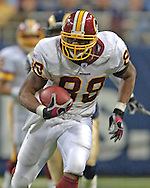 Washington Redskins tight end Robert Royal rushes up field against the St. Louis Rams at the Edward Jones Dome in St. Louis, Missouri, December 4, 2005.  The Redskins beat the Rams 24-9.