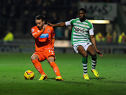 Blackpool's Stephen Dobbie turns on the spot to avoid Yeovil Town's Joel Grant - Photo mandatory by-line: Joe Meredith/JMP - Tel: Mobile: 07966 386802 03/12/2013 - SPORT - Football - Yeovil - Huish Park - Yeovil Town v Blackpool - Sky Bet Championship