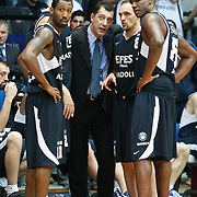 Efes Pilsen's coach Ufuk SARICA (C) and Bootsy THORNTON (L), Igor RAKOCEVIC (2ndR), Ersin DAGLI (R) during their Turkish Basketball league derby match Besiktas between Efes Pilsen at the BJK Akatlar Arena in Istanbul Turkey on Saturday 30 April 2011. Photo by TURKPIX