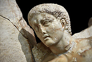 Close up of a Roman Sebasteion relief  sculpture of Orestes At Delphi Aphrodisias Museum, Aphrodisias, Turkey.   <br /> <br /> Orestes who has sought sanctuary at Delphi after murdering his mother, leaves Apollo's shrine on his way to stand trial in Athens, The hero steps gingerly over sleeping Fury; he brandishes a sword and still hold onto Apollo's tripod. The Fury has a snake and a burning torch with which she torments male factors. A small local nymph sits above on a rocky outcrop of Delphi's Mt Parnossos .<br /> <br /> If you prefer to buy from our ALAMY STOCK LIBRARY page at https://www.alamy.com/portfolio/paul-williams-funkystock/greco-roman-sculptures.html . Type -    Aphrodisias     - into LOWER SEARCH WITHIN GALLERY box - Refine search by adding a subject, place, background colour, museum etc.<br /> <br /> Visit our ROMAN WORLD PHOTO COLLECTIONS for more photos to download or buy as wall art prints https://funkystock.photoshelter.com/gallery-collection/The-Romans-Art-Artefacts-Antiquities-Historic-Sites-Pictures-Images/C0000r2uLJJo9_s0