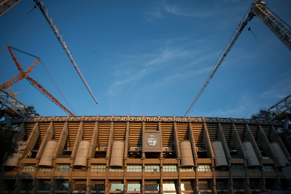 MADRID, SPAIN - OCTOBER 9: Large cranes work on the renovation of Santiago Bernabeu stadium on October 9, 2020 in Madrid, Spain. Azca, considered the business heart of the city, is a business and leisure area in Madrid spanning from Nuevos Ministerios to the Santiago Bernabeu stadium, flanked by Paseo de la Castellana and Calle Orense, two of the most iconic streets in the capital. Madrid's Mayor José Luis Martínez Almeida has announced a partnership with private investors including stock-trading companies Merlin and GMP, in order to revamp the area by promoting the development of a modern space with the best business and leisure facilities. (Photo by Miguel Pereira/Getty Images)