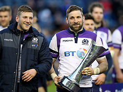 Scotland's John Barclay (right) and Finn Russell (left) with the Auld Alliance Trophy after the final whistle during the NatWest 6 Nations match at BT Murrayfield, Edinburgh.