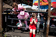 Georgia (11, wearing a pink Lolita dress) and brother Kiefer (8, wearing a red Liverpool Football Club kit) spending a day out together in Camden Town, North London. Playing after lunch. Louise is on various benefits to help support her family income, and housing, although recent government changes to benefits may affect her family drastically, possibly meaning they may have to move out of London. Louise Ryan was born on the Wirral peninsula in 1970.  She moved to London with her family in 1980.  Having lived in both Manchester and Ireland, she now lives permanently in North London with her husband and two children. Through the years Louise has battled to recover from a serious motorcycle accident in 1992 and has recently been diagnosed with Bipolar Affective Disorder. (Photo by Mike Kemp/For The Washington Post)