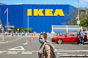 A customer wearing personal protective equipment, queuing at the IKEA Greenwich store in South London as it reopens to the public following the introduction of measures to bring England out of lockdown, Monday, Jun 1, 2020. (Photo/ Vudi Xhymshiti)