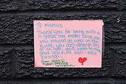 Letters of support attached to the wall of the Marcus Rashford mural displayed on the side of a cafe in Withington, south Manchester on the 6th of August 2021, Manchester, United Kingdom.  The mural has attracted huge numbers of people since the Euro 2020 final between England and Italy on 11 July and the subsequent racist abuse levied at Rashford and other black players on the England team. Based on a photograph by Daniel Cheetham, the painting of Marcus Rashford was completed in 2020 by street artist Akse, in collaboration with the street art project Withington Walls, to commemorate the footballers work to reduce child hunger.