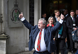 © Licensed to London News Pictures. 24/09/2019. London, UK.  IAN BLACKFORD, Westminster leader of the SNP, LIZ SAVILLE ROBERTS, Westminster leader of Plaid Cymru, and CAROLINE LUCAS of the Green Party, are seen celebrating as they leave The Supreme Court in London following a ruling on an appeal against a judicial review of Boris Johnson's suspension of Parliament. The case has been brought by remain campaigner Gina Miller, with support from former British Prime Minister John Major. Photo credit: Ben Cawthra/LNP