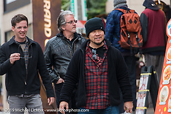Harley-Davidson's Ben McGinley, head of design Ray Drea and Dais Nagao check out the Shibuya shopping district of Tokyo. Japan. Wednesday, December 10, 2014. Photograph ©2014 Michael Lichter.