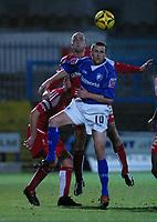 Photo: Dave Linney.<br />Chesterfield v Swindon Town. Coca Cola League 1.<br />28/12/2005.Jack Smith(Swindon) outjumps   Colin Larkin(Chesterfield)