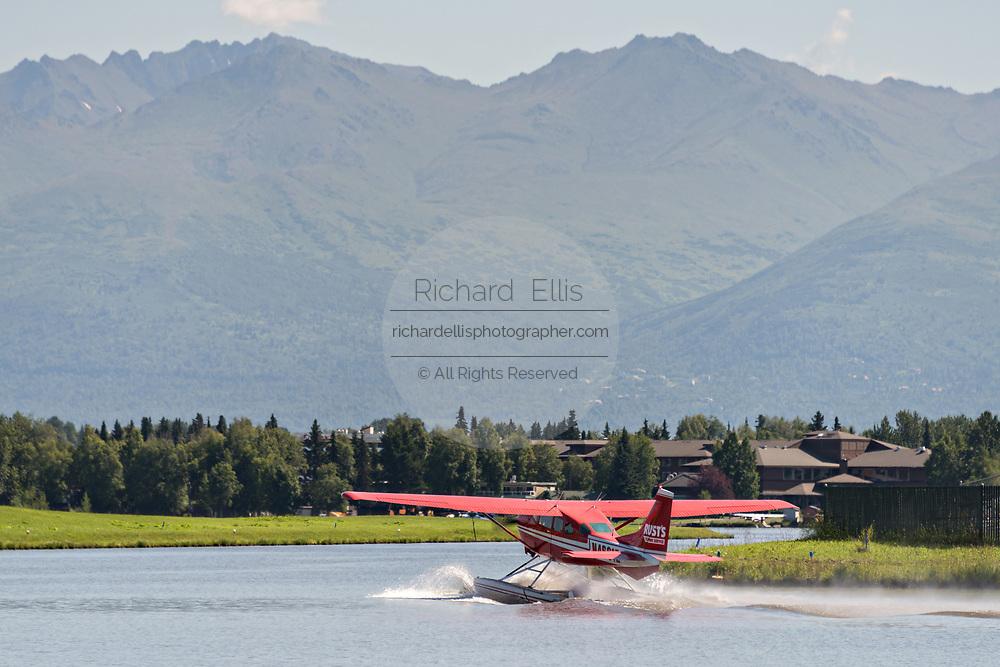 Floatplane operations at the Lake Hood Floatplane base in Anchorage, Alaska. Lake Hood is the worlds busiest float plane base handling over 200 individual flights per day.
