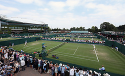 A general view of spectators watching the match action on court 8 on day three of the Wimbledon Championships at the All England Lawn Tennis and Croquet Club, Wimbledon.