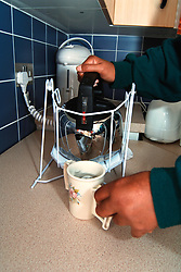 Disability aid to help pour hot water from kettle UK