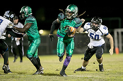November 17, 2017 - Delray Beach, Florida, U.S. - Atlantic Eagles Varrick Lurry-Davis (9) breaks away from Park Vista Cobras John Novack (50) on a punt return to the one yard line to set up the Eagles first touchdown in Delray Beach, Florida on November 17, 2017. (Credit Image: © Allen Eyestone/The Palm Beach Post via ZUMA Wire)
