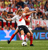 Photo: Daniel Hambury Digitalsport<br /> Arsenal v River Plate. The Sony Amsterdam Tournament. 2004.   30/7/04<br /> <br /> Arsenal's Pascal Cygan and River Plate's Maximiliano Lopez