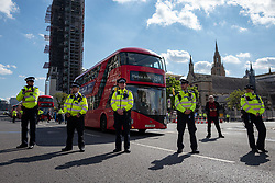 © Licensed to London News Pictures. 01/09/2020. London, UK. Police officers form a line outside Parliament as members of the Extinction Rebellion (XR) environmental campaign group gather in central London to blockade Parliament. XR plan to peacefully disrupt the UK Parliament with actions planned over two weeks, until MPs back the Climate and Ecological Emergency Bill and prepare for crisis with a National Citizens' Assembly. Photo credit: Rob Pinney/LNP