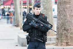 © Licensed to London News Pictures. 08/01/2016. France, Paris. Heavily armed police precense can be seen on Place De La Republique where preparations have begun for Sunday's public remembrance of the Charlie Hebdo Victims. Today January 8th 2016. Photo credit: Hugo Michiels/LNP