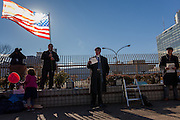A Rabbi speaks next than American Flag at a protest march and rally organised by the Alliance for an Inclusive America group against the perceived anti-Muslim and anti-foreigner immigration policies of President Donald Trump, Shibuya, Tokyo, Japan. Sunday February 12th 2017. The Alliance of an Inclusive America is a multi-faith non-partisan group. About 250 Americans, other ex-pats and japanese people took part in the march to show people around the world they reject the Executive Order President Trump enacted at the end of January, indefinitely suspending the resettlement of Syrian refugees and temporarily banning people from seven majority Muslim countries from entering the United States.