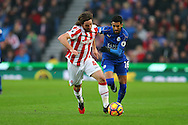 Joe Allen of Stoke City gets away from Riyad Mahrez of Leicester City. Premier league match, Stoke City v Leicester City at the Bet365 Stadium in Stoke on Trent, Staffs on Saturday 17th December 2016.<br /> pic by Chris Stading, Andrew Orchard sports photography.