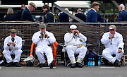 © Licensed to London News Pictures. 16/09/2012. Goodwood, UK . Trackside engineers take a break. People enjoy the atmosphere at the 2012 Goodwood Revival. The event recreates the glorious days of motor racing and participants are encouraged to dress in period dress. Photo credit : Stephen Simpson/LNP
