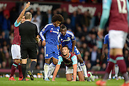 Ramires of Chelsea pulling Andy Carroll of West Ham United up from the ground. Barclays Premier League, West Ham Utd v Chelsea at The Boleyn Ground, Upton Park in London on Saturday 24th October 2015.<br /> pic by John Patrick Fletcher, Andrew Orchard sports photography.