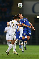 Kalvin Phillips of Leeds Utd (l) jumps for a header with Craig Bryson of Cardiff city ®.  EFL Skybet championship match, Cardiff city v Leeds Utd at the Cardiff city stadium in Cardiff, South Wales on Tuesday 26th September 2017.<br /> pic by Andrew Orchard, Andrew Orchard sports photography.