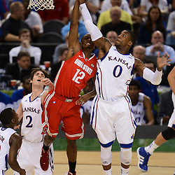 Mar 31, 2012; New Orleans, LA, USA; Kansas Jayhawks forward Thomas Robinson (0) grabs a rebound over Ohio State Buckeyes forward Sam Thompson (12) during the first half in the semifinals of the 2012 NCAA men's basketball Final Four at the Mercedes-Benz Superdome. Mandatory Credit: Derick E. Hingle-US PRESSWIRE