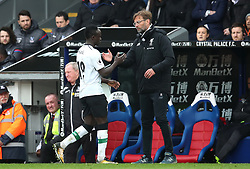 Liverpool's Sadio Mane (left) is substituted by Liverpool manager Jurgen Klopp during the Premier League match at Selhurst Park, London.