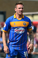 Shrewsbury Captain Liam Lawrence during the Sky Bet League 2 match between Cheltenham Town and Shrewsbury Town at Whaddon Road, Cheltenham, England on 25 April 2015. Photo by Alan Franklin.