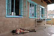 A sick patient sleeps outside because of the heat at Lokitaung district hospital in Turkana, Northern Kenya. The hospital is run and funded by the Merlin project.